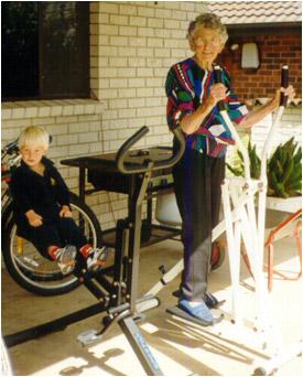 Elderly Grandmother and Boy Exercising