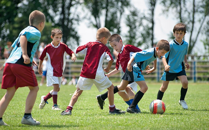 kids playing team soccer