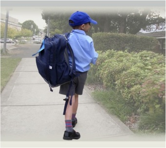 scoliosis in boy carrying schoolbag